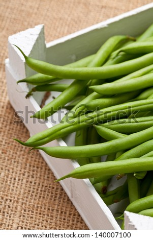 Organic pole beans in white wooden crate