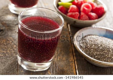 Organic Raspberry and Chia Seed Beverage against a background