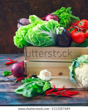 Organic raw vegitables in wooden box. Healthy diet and nutrition concept. Agriculture and farming