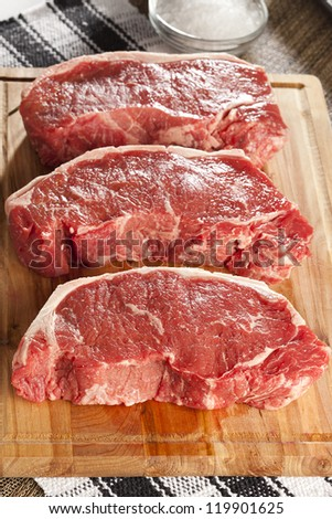 Organic Red Raw Steak Sirloin against a background