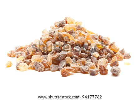 Organic rock candy sugar over white background