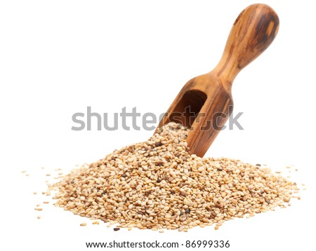 Organic sesame seeds with wooden scoop over white background