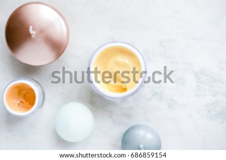 Organic skincare cosmetics on white marble background. Creams, balms, masks, oils, serums. Top view.  Beauty blogger concept #686859154