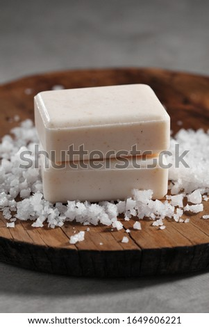 Organic soap and salt for spa on rustic background.