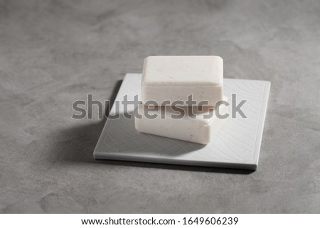 Organic soap for spa on rustic background.
