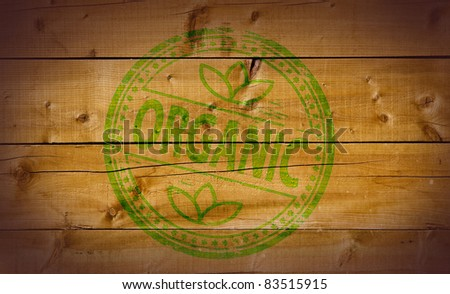 Organic stamp on wooden background