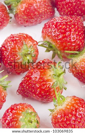 organic strawberries are cleaned prior to processing