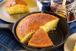 Organic sweet cornbread baked in castiron pan.