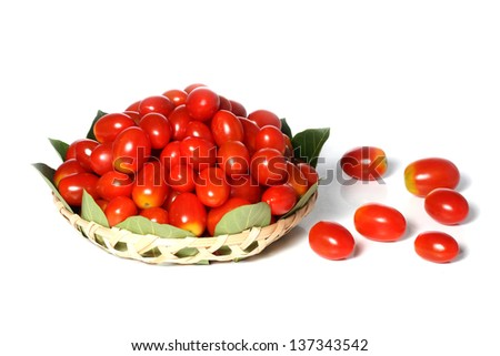 Organic tomatoes on bamboo basket isolated on white