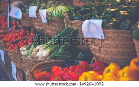 Organic vegetable stall at a farmer's market and selling fresh vegetables from garden. Local produce at the summer farmers market in the city. ストックフォト ©