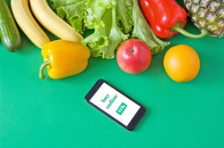 Organic Vegetables and fruits and phone with copy space, online market, food delivery at home concept