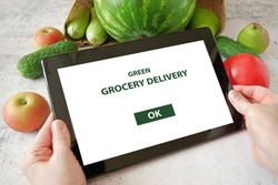 Organic Vegetables and fruits, tablet pc in wooden box, online market, green grocery delivery at home concept, buy online