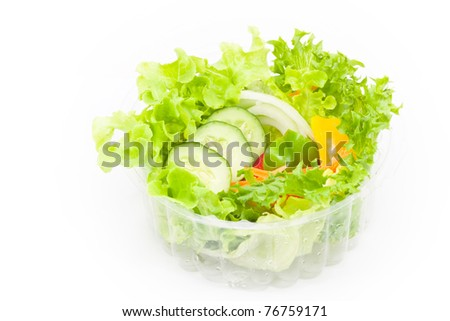 Organic vegetables salad in plastic bowl on white background