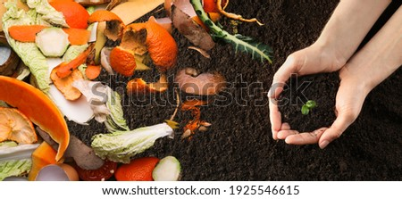 Organic waste for composting on soil and woman holding green seedling, top view. Natural fertilizer  Foto stock ©