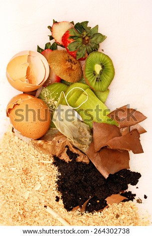Organic waste over white background, used to make home compost, vertical image