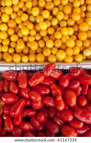 organic yellow and red tomatoes in boxes