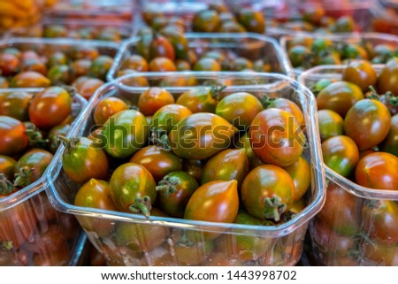 Organics green red cherry tomatoes sold on farmers market