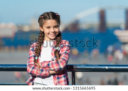 Organize activities for teenagers. Vacation and leisure. What do on holidays. Sunny day walk. Leisure options. Free time and leisure. Girl cute kid with braids relaxing urban background defocused.