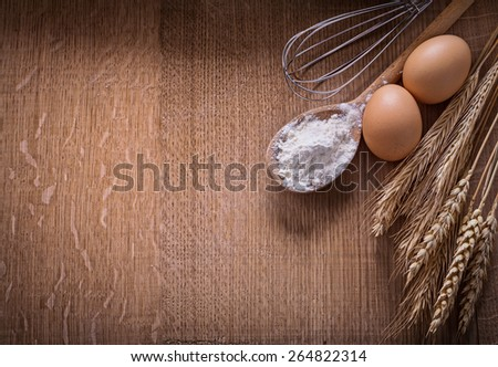 organized copyspace flouur in spoon eggs ears of wheat on wooden board food and drink still life