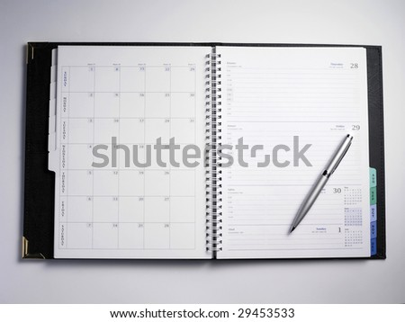 organizer with calender and line page with pen