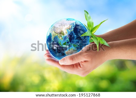 orient in hands - environmental concept -maps elements of this image furnished by NASA