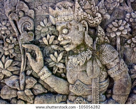 Oriental background. Man surrounded by floral ornament. From a balinese temple