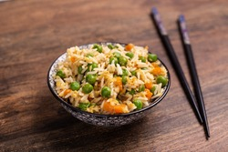 Oriental cantonese rice. Basmati rice with green peas, eggs and carrots.