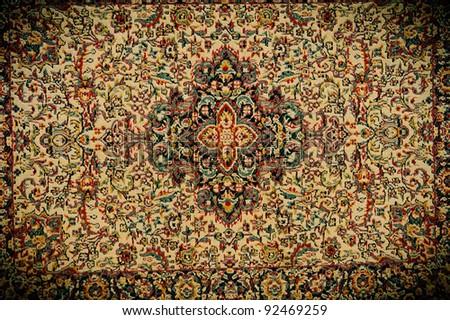 Oriental carpet texture. Dark image, dramatic light