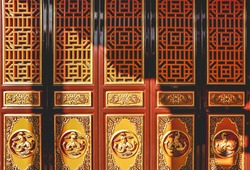 Oriental crafted Chinese folding door background with a shadow of sunlight