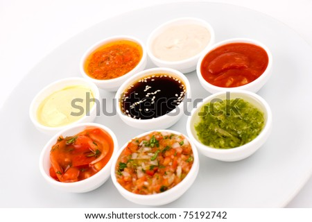 oriental cuisine - several sauceboats with different sauces and seasonings