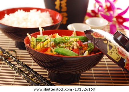 oriental dinner with bowl of deep fried chicken ,vegetables  and rice