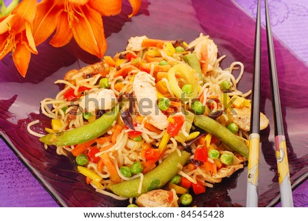 oriental dinner with deep fried chicken,vegetables and noodles