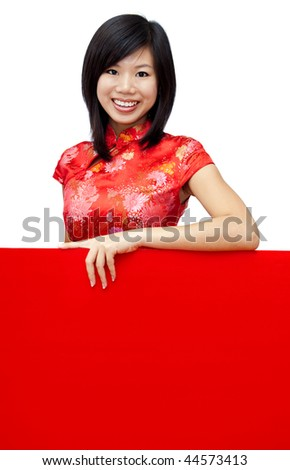 Oriental girl with blank sign. - stock photo