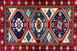 Oriental handmade woolen carpet background