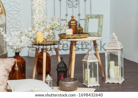 Oriental lanterns and interior details in the Arabic Turkish style. Moroccan middle East Decoration in Oriental style design. White room in Oriental style
