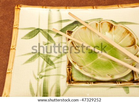 Oriental Leaf Bowl  with Chopsticks on Large Bamboo Plate