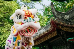 oriental lion dance in a traditional ancient Chinese garden