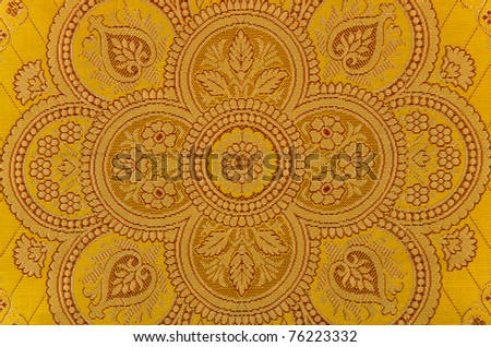Oriental ornamented textile closeup.