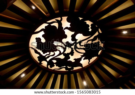 Oriental pattern on the ceiling lamp. Ceiling with light patterns. Abstract interior background. #1565083015