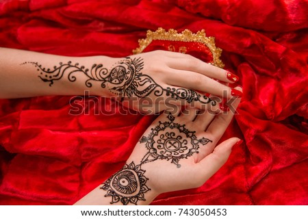 Oriental picture on woman hand palm, horizontal banner. mehendi traditional decoration, resistant design, brown henna tattoo art. Saloon service style, mandala lily flower, bright red cloth background