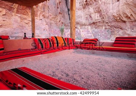 oriental red coach on desert - stock photo