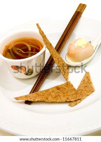 Oriental sweet and sour soup served with scallop stuffed with shrimps