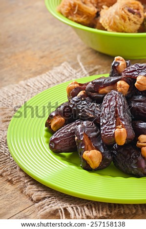 Oriental sweets - sun dried dates stuffed with cashew #257158138