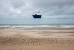 Orientation pole on an empty North Sea beach in Belgium.