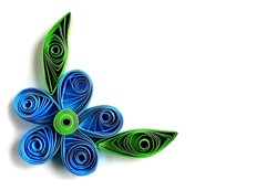 Origami blue flower & paper green leaves frame in quilling technique. Beautiful origami paper flower with leaves - quilling art element. Handmade kids quilling origami flower & leaves from color paper