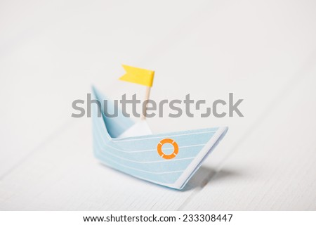 Origami boat, paper boat with yellow flag