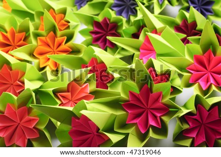Origami bunch of various rainbow flowers isolated on white