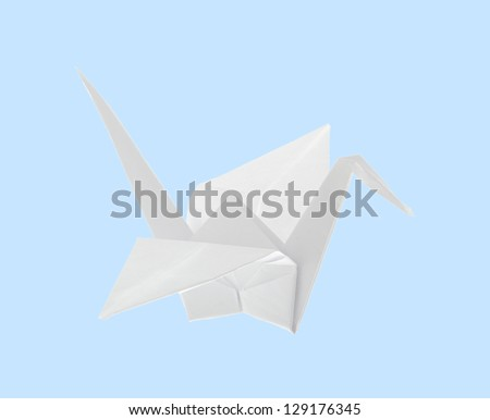 Origami crane isolated on light blue background. Easy to isolate