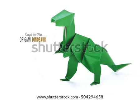 Origami dinosaur on white #504294658