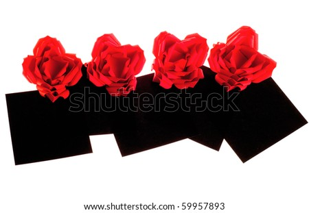 Origami flower red roses and black paper isolated on white